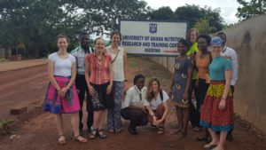 Interns stand outside Ghana facility